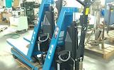 21-32-111 Elektrinis - hidraulinis aukšto pakėlimo padėklų vežimėlis NH SLX 1000E